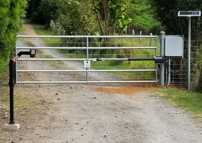 A standard entry automated gate system with solar panel.
