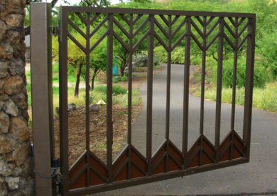 Designed metal entry gate with arrow motif