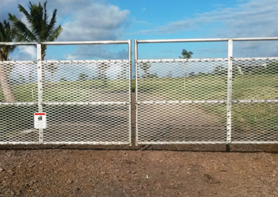 Double metal automated gate system over driveway, home entrance.