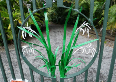 Detailed metal fabrication of rice plant on a metal gate in green